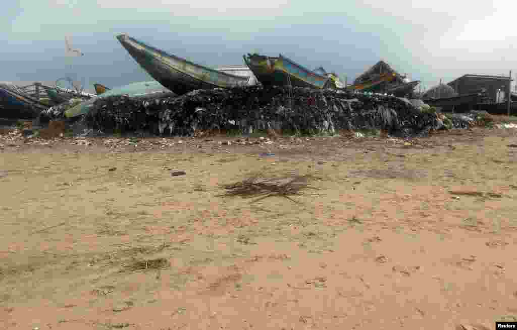 Boats are seen on an eroded shore after Cyclone Phailin hit Puri in the eastern Indian state of Odisha, Oct. 14, 2013.