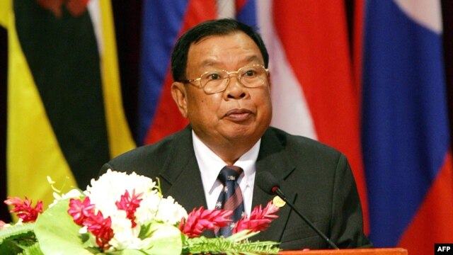FILE - In this file picture taken on July 26, 2005, then Lao Prime Minister Bounnhang Vorachith addresses the opening ceremony of the 36th annual ministerial meeting of the Association of Southeast Asian Nations (ASEAN) in Vientiane.