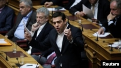 Greek Prime Minister Alexis Tsipras answers a question on the results of the latest Eurogroup during the Prime Minister's Question Time at the parliament in Athens, Greece, Feb. 24, 2017.