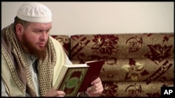 FILE - This image provided by New Zealand 3 News/MediaWorks via APTN shows Mark Taylor, who converted to Islam and is now thought to be in Syria, as he reads the Quran in his native New Zealand.