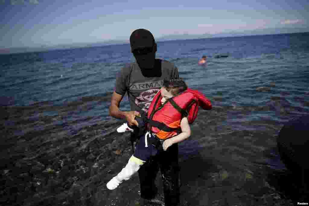 Migrants and refugees continue to make the sometimes dangerous journey to Europe. These Syrian refugees arrived in a small boat on the Greek island of Lesbos.
