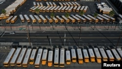 FILE - Parked school buses are seen after California issued a stay-at-home order as the spread of the coronavirus disease continues, in Los Angeles, California, U.S., April 3, 2020. (REUTERS/Lucy Nicholson/File Photo)