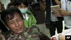 An injured Thai soldier is treated on his arrival at Kantharalak, hospital in Si Sa ket Province, Thailand Sunday, Feb. 6, 2011