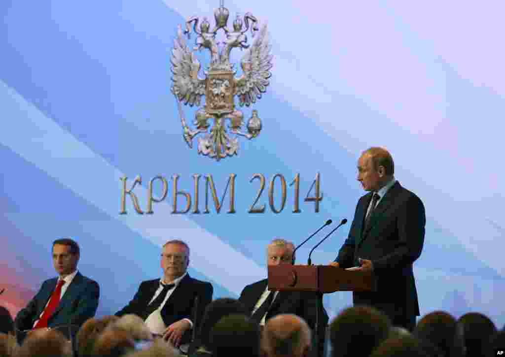 "President Vladimir Putin addresses members of Crimea parliament. While in a meeting with lawmakers he commented that his country was doing ""all we can to stop bloodshed in Ukraine as soon as possible,"" about 30 km from Yalta, Crimea. Aug. 14, 2014."
