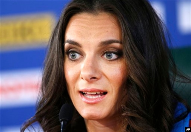 FILE - Russia's Yelena Isinbayeva, the gold medalist in the women's pole vault, speaks during a press conference at the World Athletics Championships in the Luzhniki stadium in Moscow, Russia, Aug. 15, 2013.