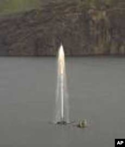 A plume of water on Lake Nyos includes combustible gases that gather along the bottom