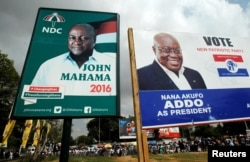 FILE - Campaign billboard show John Mahama, at the time Ghana's president and National Democratic Congress presidential candidate, and the opposition New Patriotic Party presidential candidate, Nana Akufo-Addo, on a street in Accra, Dec. 3, 2016. Akufo-Addo defeated Mahama by a million votes.