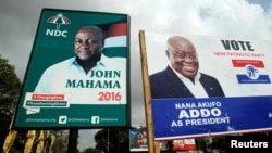 A campaign billboard shows John Mahama, Ghana's president and National Democratic Congress presidential candidate, and the opposition New Patriotic Party presidential candidate, Nana Addo, on a street in Accra, Dec. 3, 2016.