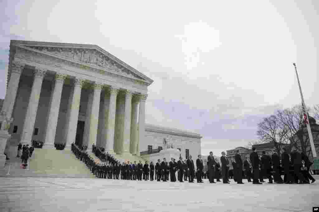 The casket of Supreme Court Justice Antonin Scalia arrives at the Supreme Court in Washington, Feb. 19, 2016.