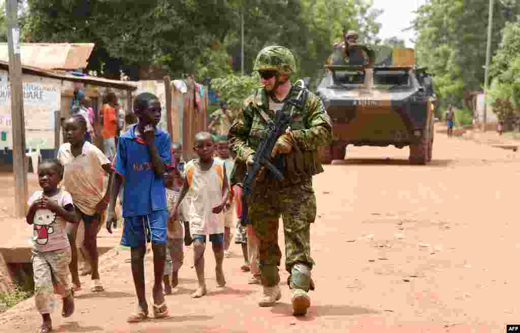 An Estonian soldier of the European Union Force in the Central African Republic patrols a street in Bangui.