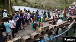 Un puente dañado luego del tifón Hagupit en el centro de Filipinas, en diciembre de 2014. Se viene una mayor migración provocada por los eventos climáticos extremos.