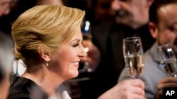 Kolinda Grabar-Kitarivic celebrates her victory in presidential elections, in Zagreb, Croatia, Jan. 11, 2015.