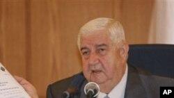 기자회견 중인 알-모알렘 시리아 외교장관