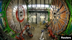 FILE - Overview of the first element (L) of the huge magnet of the CMS (Compact Muon Solenoid) experimental site at the European Organization for Nuclear Research CERN (Centre Europeen de Recherche Nucleaire) before its lowering on Thursday in the French village of Cessy in 2006.