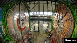 Overview of the first element (L) of the huge magnet of the CMS (Compact Muon Solenoid) experimental site at the European Organization for Nuclear Research CERN (Centre Europeen de Recherche Nucleaire) before its lowering on Thursday in the French village