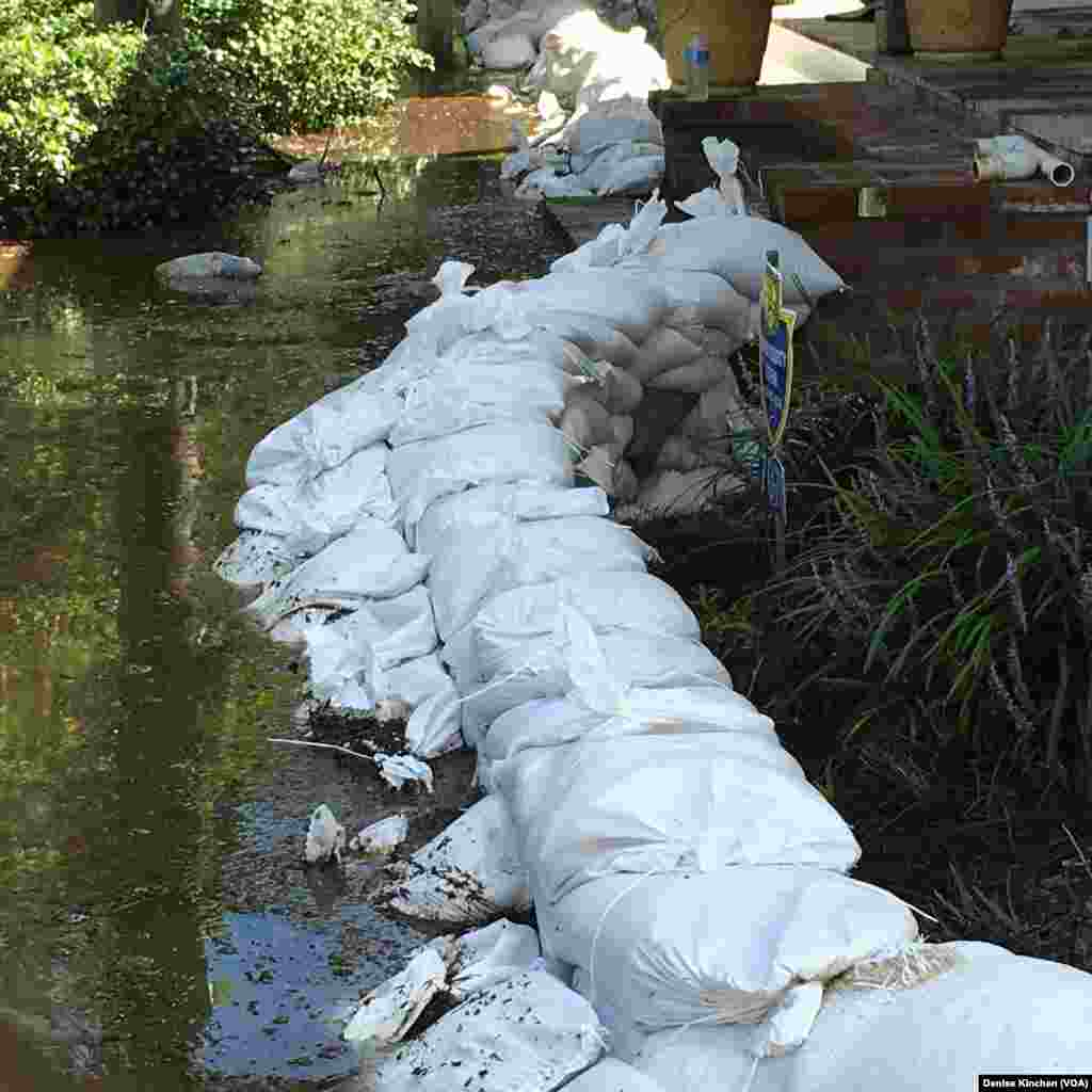 Sandbags are used to keep floodwaters away from the Kinchen family's home, in of St. Amant, La., Aug. 18, 2016.