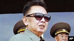 An undated file photo of N. Korean leader Kim Jong-Il (L) inspecting Combined Unit 597 of the Korean People's Army Navy and combined maneuvers at undisclosed location