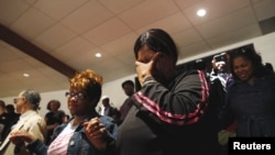 Mourners react during funeral services for 25-year old Freddie Gray, a Baltimore black man who died in police custody, at New Shiloh Baptist Church in Baltimore, Maryland, April 27, 2015.