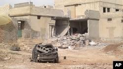 Damaged building are seen in Taftanaz village, east of Idlib city, Syria, April 5 , 2012.