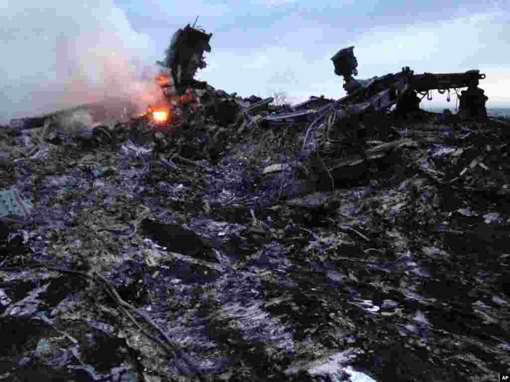 Smoke rises up at a crash site of a passenger plane, near the village of Grabovo, Ukraine.