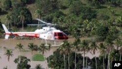 A handout picture released by Alagoas Agency on June 21, 2010 shows a fire brigade helicopter fliying over Rio Largo, Alagoas State, northeastern Brazil, looking for victims following the overflowing of the Mandau river on 20 June 2010
