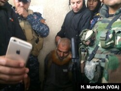 The day after capturing this Mosul neighborhood, Iraqi forces arrested this suspected militant after being informed of his whereabouts by civilian neighbors in Mosul, Mar. 2, 2017.