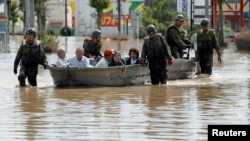 Japan Self-Defense Force soldiers rescue people from a flooded area in Mabi town in Kurashiki, Okayama Prefecture, Japan, July 8, 2018.