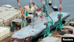 Japan Unveils Biggest Warship Since WWII