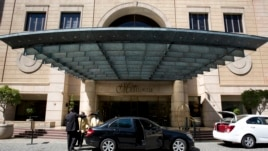 "A picture taken on January 2, 2014 in Johannesburg shows the entrance of the ""Michelangelo"" Hotel."