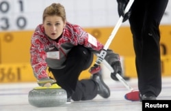 FILE - Russia's second Margarita Fomina watches a stone during their World Women's Curling Championship qualification round match against Japan in Riga, March 20, 2013.