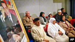 FILE - Alleged victims of repression attend public hearings in Rabat of the Moroccan Equity and Reconciliation Commission, Dec. 21, 2004. The hearings gave a platform to victims of human rights abuses dating back decades.