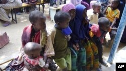 FILE - In this file photo of Thursday June 26, 2009,Somali children waiting to be registered at U.N. registration center in Dagahaley, Northeastern Kenya. More than 800 Somali children arrive each day at overcrowded refugee camps in northeastern Kenya to