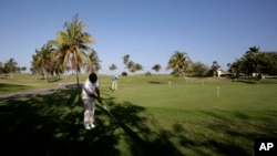 FILE - Players are seen on an existing golf course in Varadero, Cuba, in an April 24, 2010, photo.