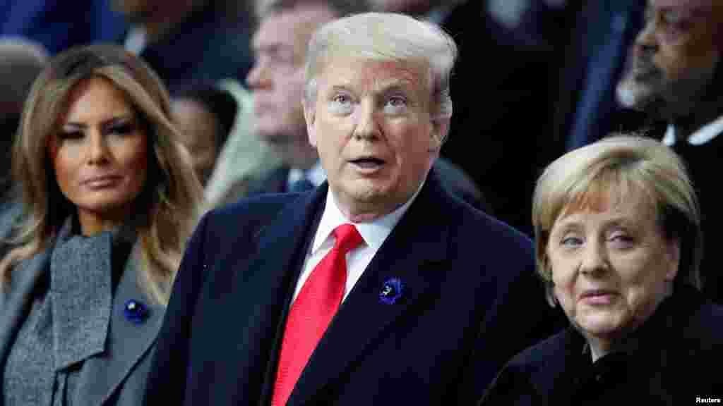 صدر ڈونلڈ ٹرمپ ان کی اہلیہ اور جرمن چانسلر مرکل