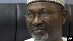 FILE - Independent National Electoral Commission (INEC) Chairman Attahiru Jega displays the timetable.
