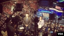 VOA Serbian's Bratislav Djordjevic (L) and VOA Spanish's Lina Correa (R) reporting from the DNC.
