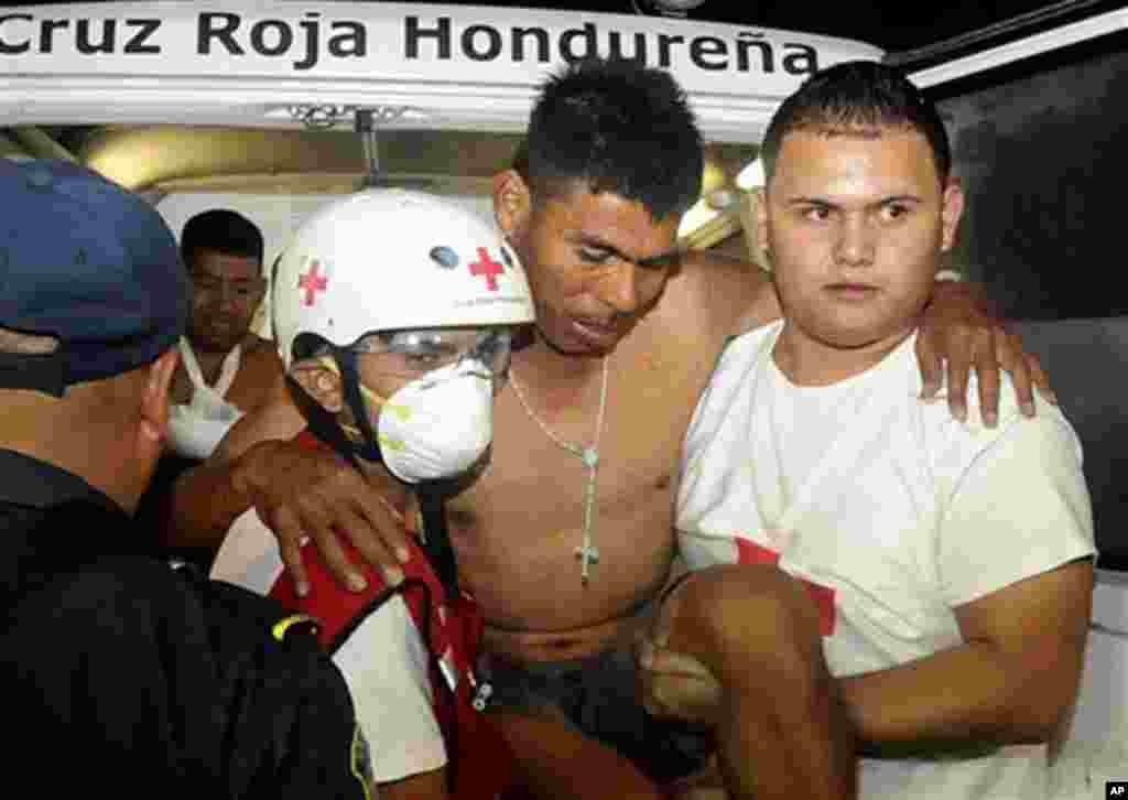An injured inmate arrives at the hospital after a fire broke out at the prison in Comayagua, Honduras, early February 15, 2012. (AP)
