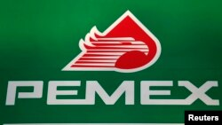 FILE - The logo of Mexican state-owned oil company Pemex is seen at a Mexico City gas station.
