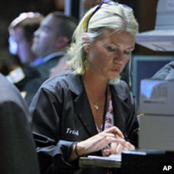 Traders work on the floor of the New York Stock Exchange (File)
