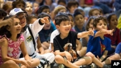 Children attending a summer school program in Cos Cob, Connecticut, last August. Educators are now discussing how to best teach English learners. (Chris Palermo/Hearst Connecticut Media via AP)
