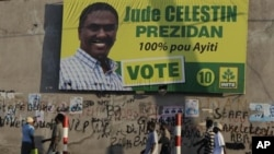 People walk next to a banner of presidential candidate Jude Celestin in Port-au-Prince, Haiti, Jan 26, 2011