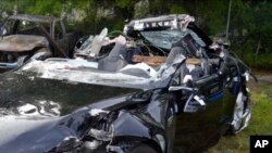 FILE - In this photo provided by the National Transportation Safety Board via the Florida Highway Patrol, a Tesla Model S that was being driven by Joshua Brown, who was killed when the Tesla sedan crashed while in self-driving mode on May 7, 2016. The NTSB released the results of its investigation Monday.
