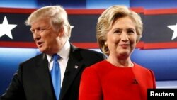 Republican U.S. presidential nominee Donald Trump and Democratic U.S. presidential nominee Hillary Clinton greet one another as they take the stage for their first debate at Hofstra University in Hempstead, New York, Sept. 26, 2016.