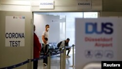 FILE - Travelers line up at the new Corona Test Center at Duesseldorf Airport in Duesseldorf, Germany.