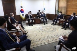 U.S. Special Representative for North Korea, Sung Kim, center left, and South Korean Unification Minister Lee In-young, center right, discuss issues concerning North Korea, at the unification ministry, June 22, 2021, in Seoul, South Korea.