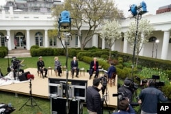 President Donald Trump speaks with Fox News Channel Anchor Bill Hemmer during a Fox News Channel virtual town hall, at the White House, in Washington, March 24, 2020.