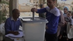 Defiant Assad Votes in Syria's Sham Poll