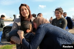 Relatives hug a Yazidi survivor boy following his release from Islamic State militants in Syria, in Duhok, Iraq, March 2, 2019.