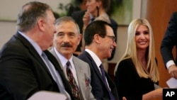 Secretary of State Mike Pompeo, left, U.S. Ambassador to South Korea Harry Harris, Treasury Secretary Steve Mnuchin and White House Adviser Ivanka Trump chat together before a news conference by President Donald Trump and South Korean President Moon…