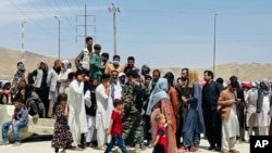 FILE - Hundreds of people gather outside the international airport in Kabul, Afghanistan, Aug. 17, 2021. Some of those unable to leave Afghanistan before the American military withdrawal include winners of the diversity visa program.